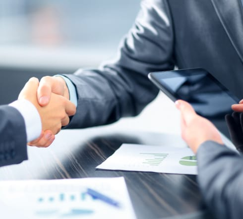 image of two people shaking hands after the purchase of a Surety Bond for their Bartlett TN Business.