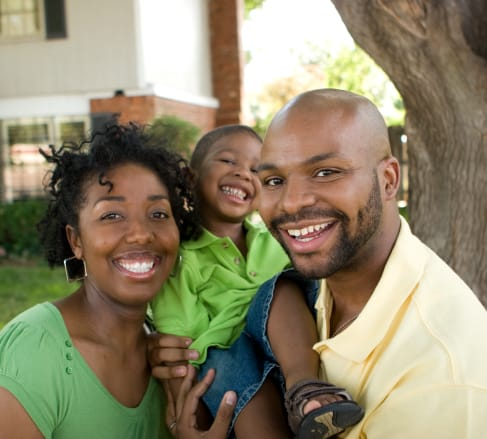 image of a family buying the best affordable life insurance they can in Bartlett TN while carrying their child